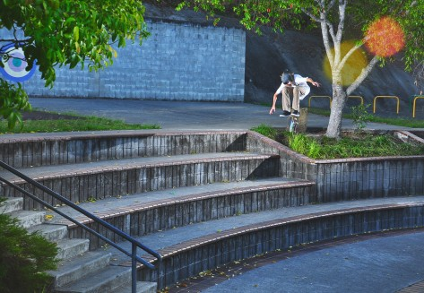 Kobe catching a well flicking varial heelflip down a sizeable 4 block