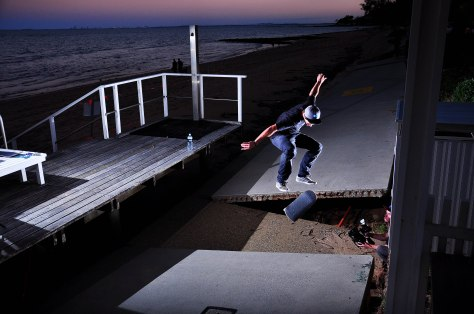 Jarrod kickflips over a street gap created with a little assistance from mother nature